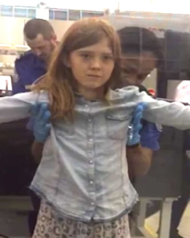 Vendela Payne being patted down by TSA agent