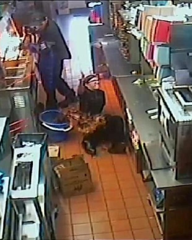 McDonald's Worker Falls Into Bucket Of Hot Oil (Video) Promo Image