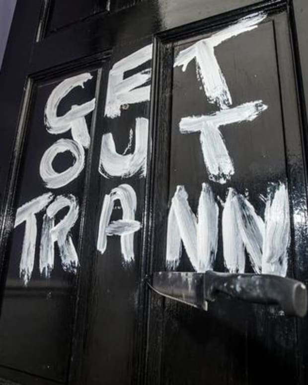 'Get Out Tranny' written on door