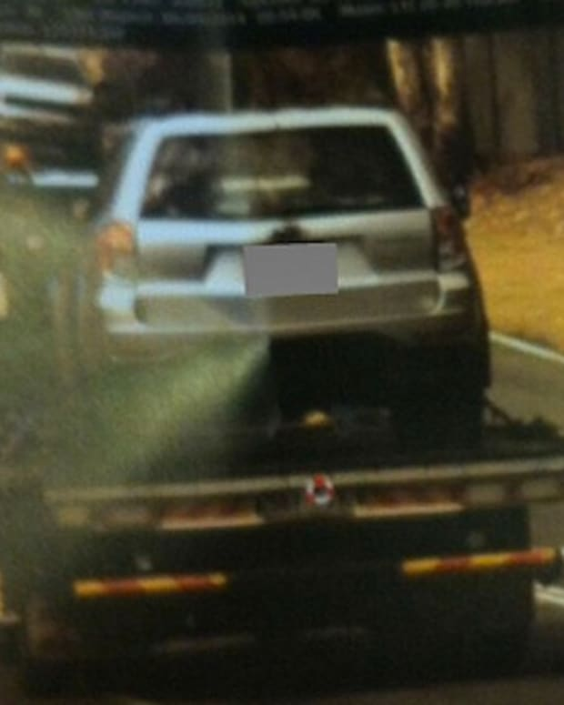 driver's car being towed and getting a speeding ticket