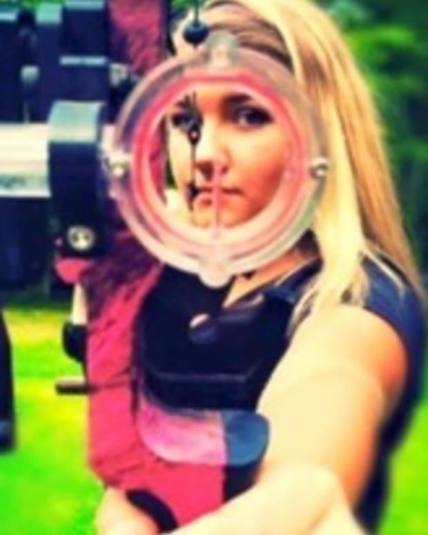 Jordyn aiming her bow