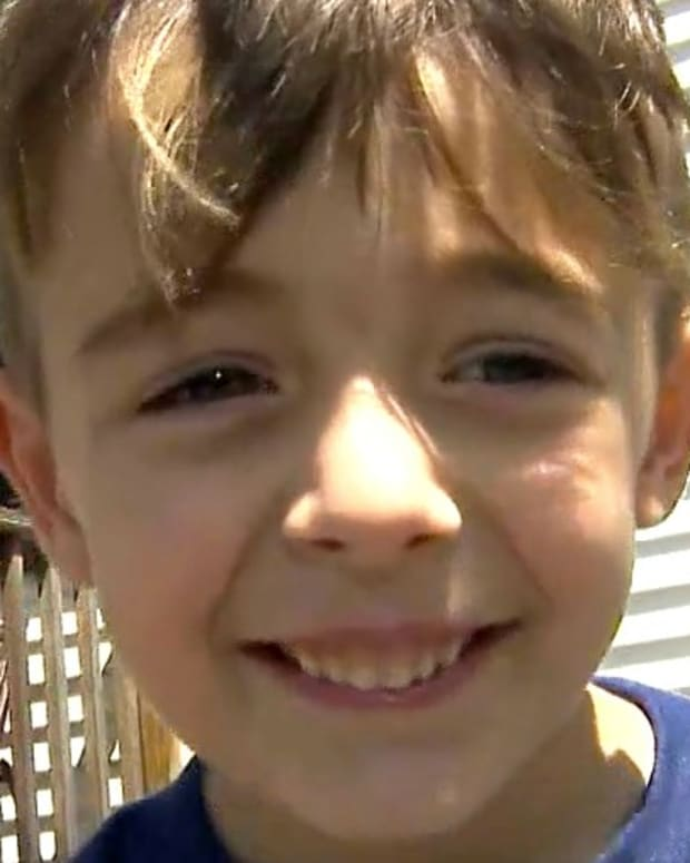 Boy Calls 911, Says His Dad Ran Red Light (Video) Promo Image
