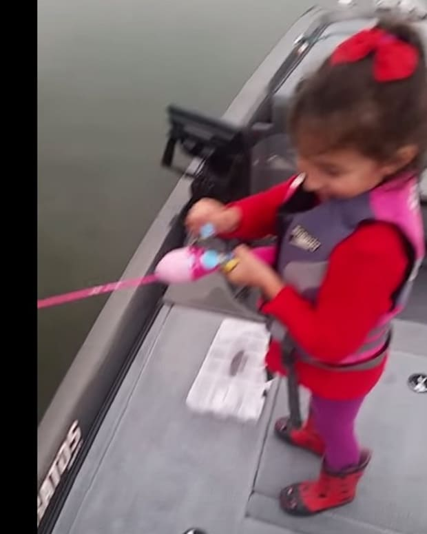 Screenshot, girl with Barbie fishing pole