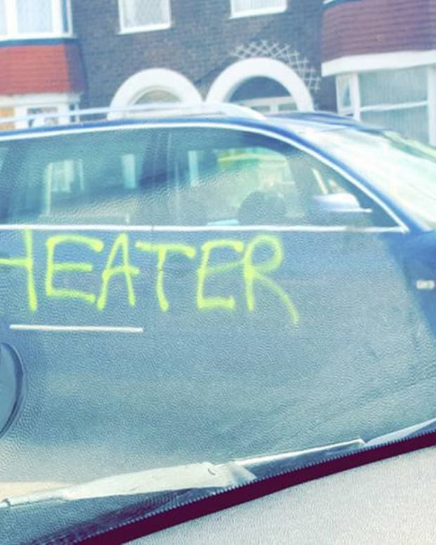 Man's Car Branded With 'Cheater' In Graffiti  Promo Image