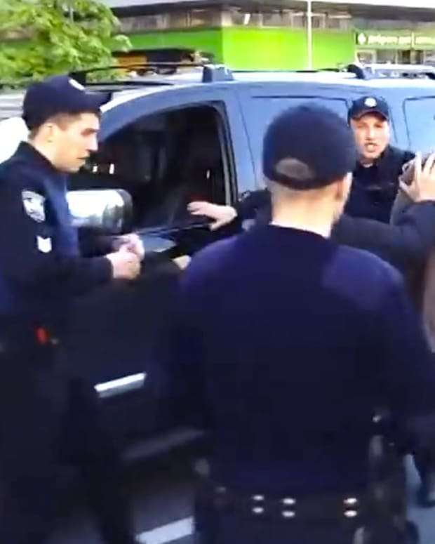 Olympic Champion Wrestler Takes On Seven Cops (Video) Promo Image