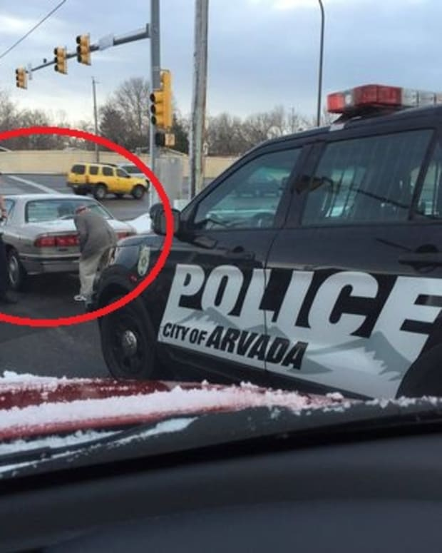 officer sam glynn helping an elderly man