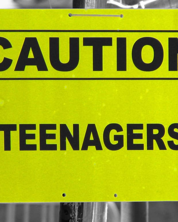 'Caution: Teenagers' sign