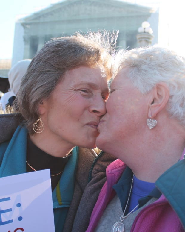 same sex couple kissing in front of U.S. Supreme Court building