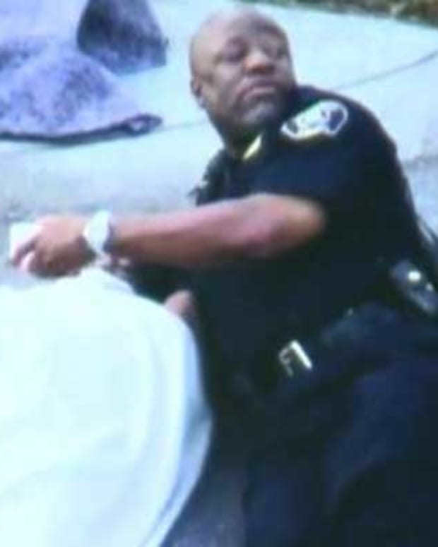 Lt. Joe Tucker comforts Johntez Byrd after a car accident