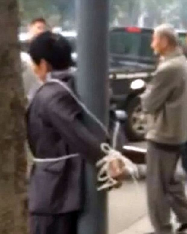 stalker in china tied to pole