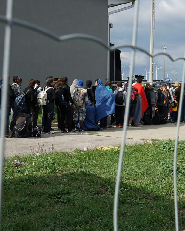 Migrants wait to enter Germany