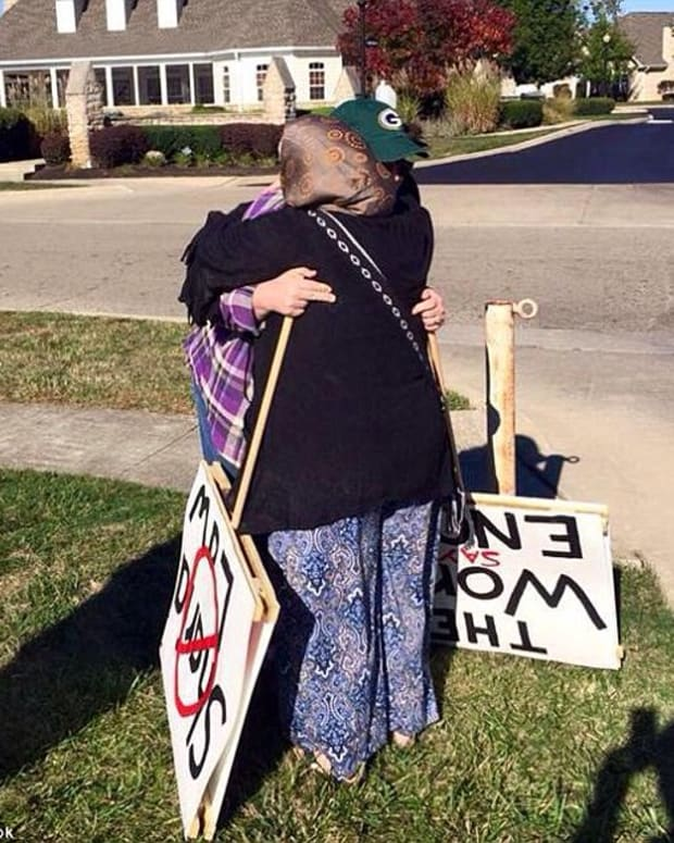Protester hugs mosque supporter