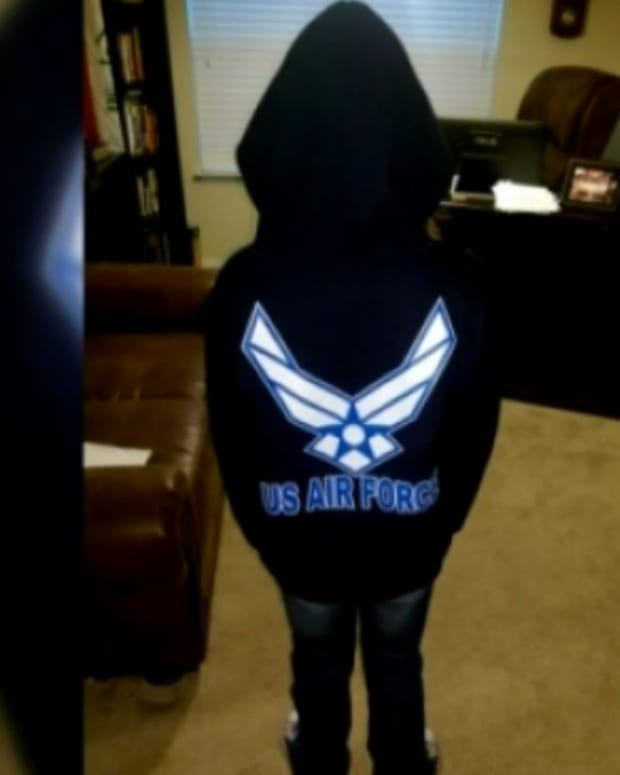 girl in U.S. Air Force sweatshirt