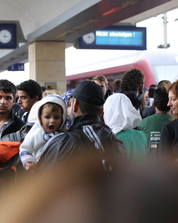 Syrian Refugees Waiting For A Train In Vienna.