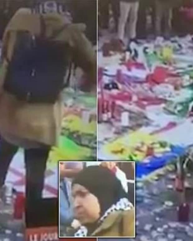 Woman Rips Up Israeli Flag At Brussels Memorial (Video) Promo Image