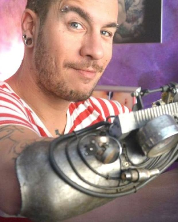 Man's Prosthetic Arm Is Also Tattoo Machine (Video) Promo Image