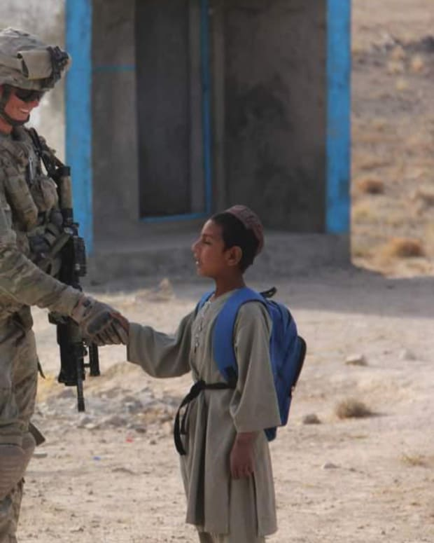 A Soldier And A Boy In Afghanistan.