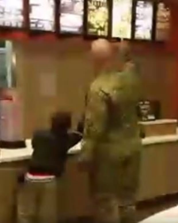 A Soldier Buying Two Children A Meal
