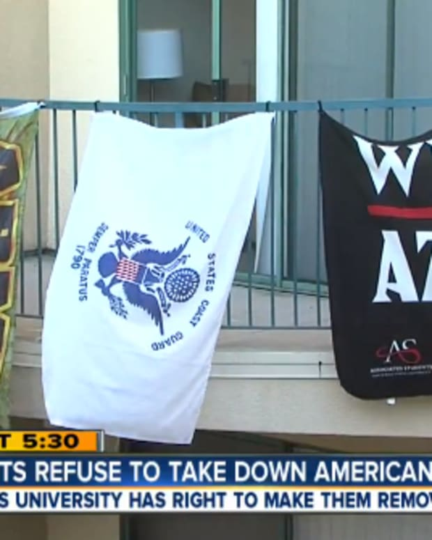 American Military Flags hanging outside college students' apartment