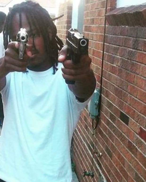 Denzel Biggs Appears To Hold Two Handguns In His Facebook Photo