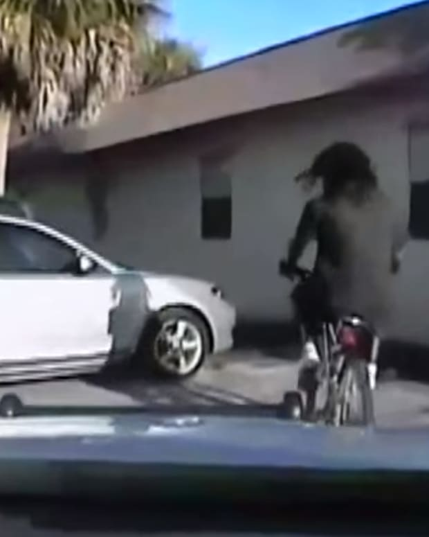 screenshot, Stephens riding a bike before Lin shot him