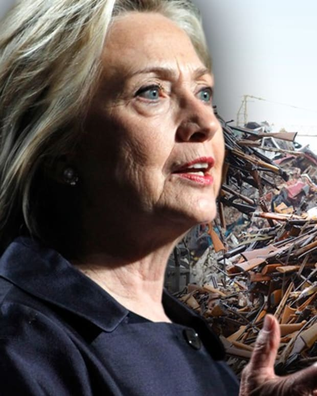 Hillary Clinton and pile of guns