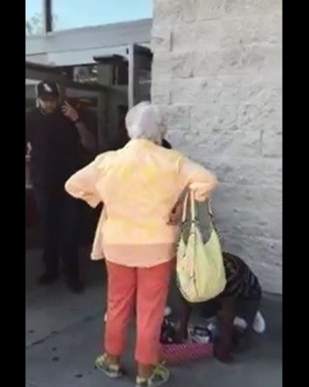 Elderly Woman Harasses Kid Selling Candy (Video) Promo Image