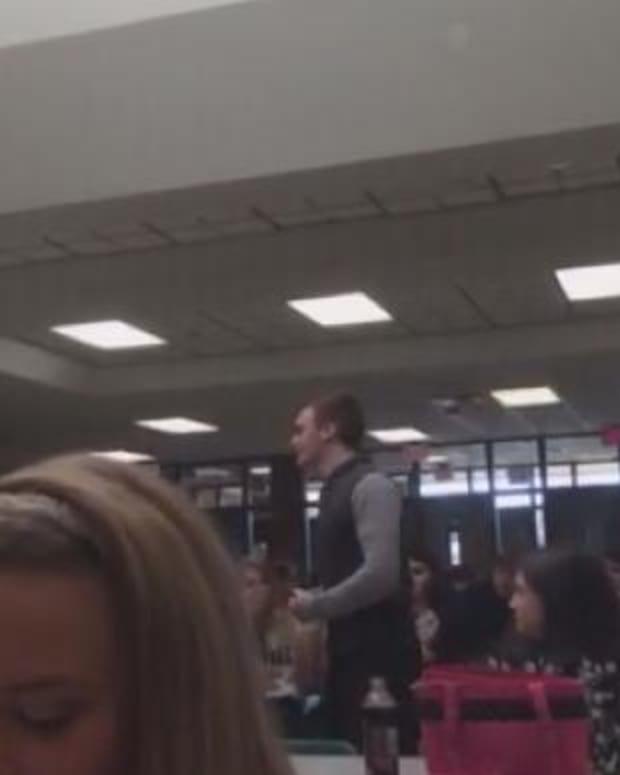 Matthew Clark speaking in the cafeteria