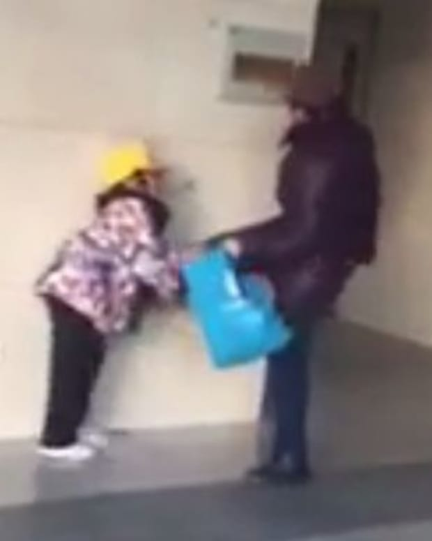 Grandma Beating Child.