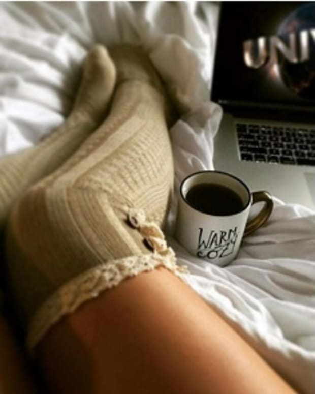 girl's facebook photo featuring socks, computer and cup of coffee