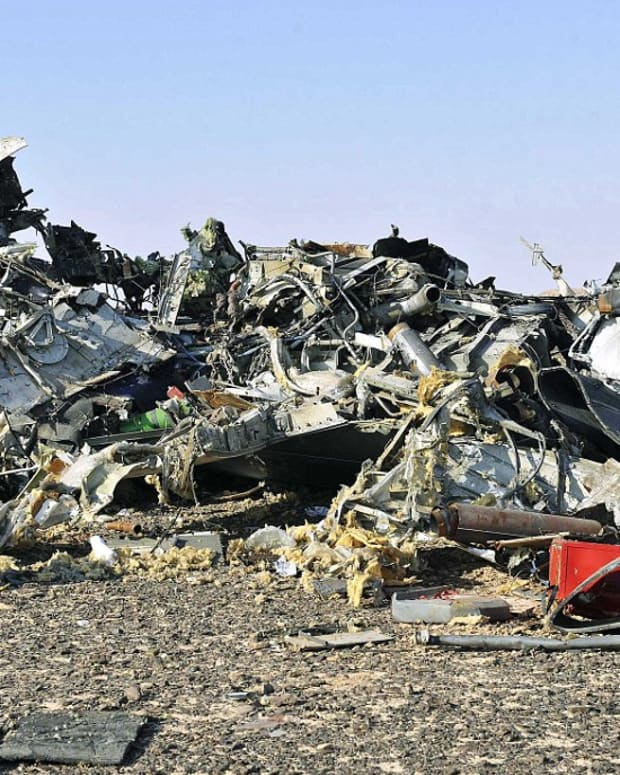 the wreckage of the russian plane that crashed and killed 224 people