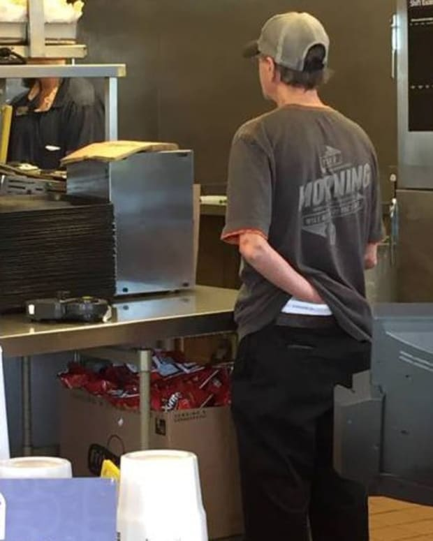 Taco Bell employee with hand down his pants