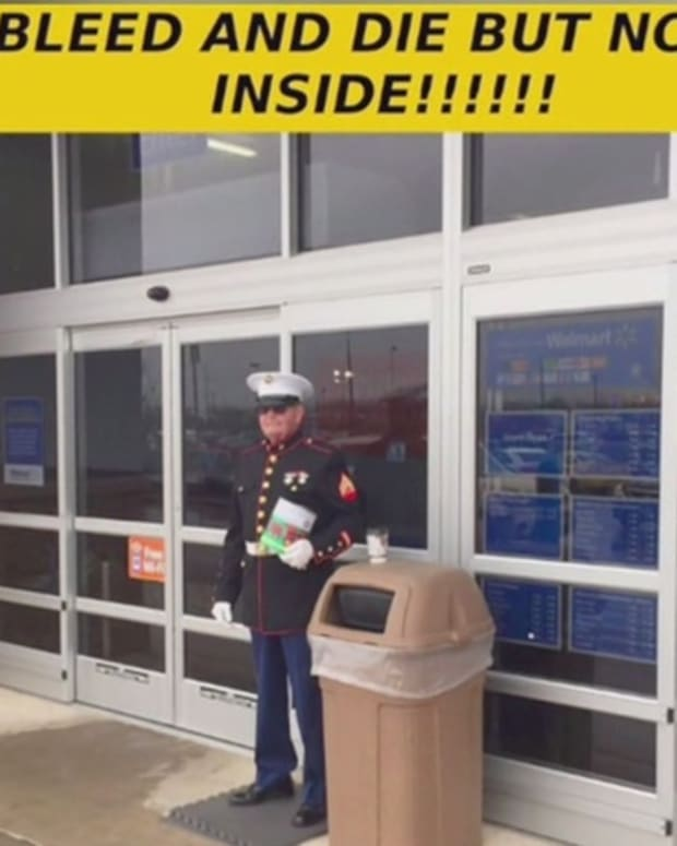 Veteran Marine John Harkness standing outside Walmart store
