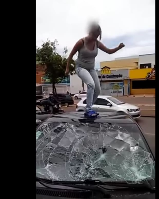 Woman Destroying Husband's Car.