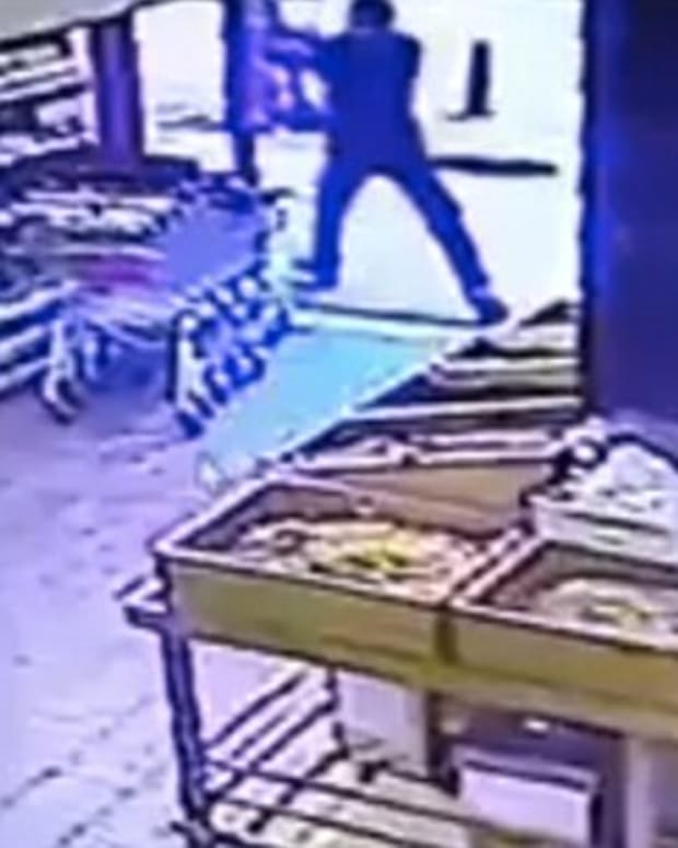 CCTV footage shows the shooter opening fire on a Tel Aviv bar from inside a neighboring grocery store on Jan. 1