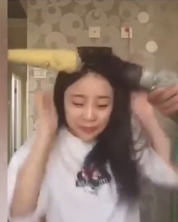 Chinese Girl Loses Hair In Risky Challenge (Video) Promo Image