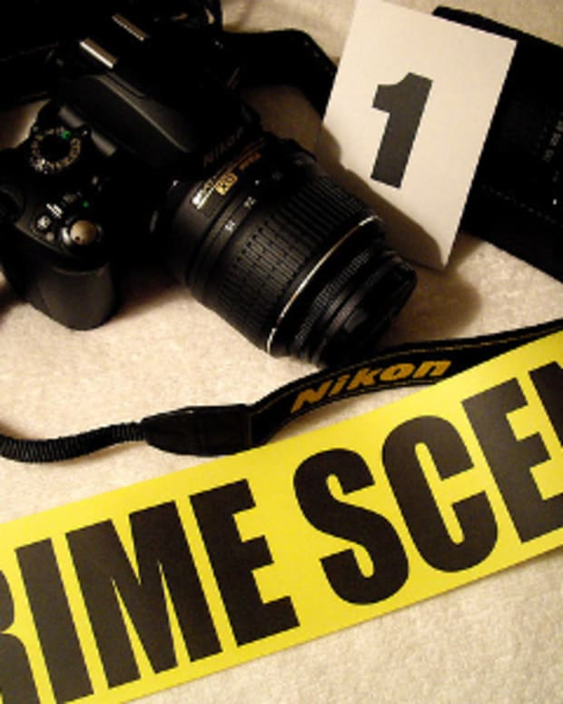 Crime Scene tape and camera