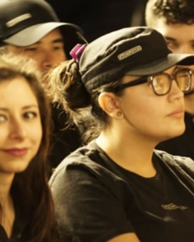 Chipotle employees listen during a company-wide presentation on Feb. 8.