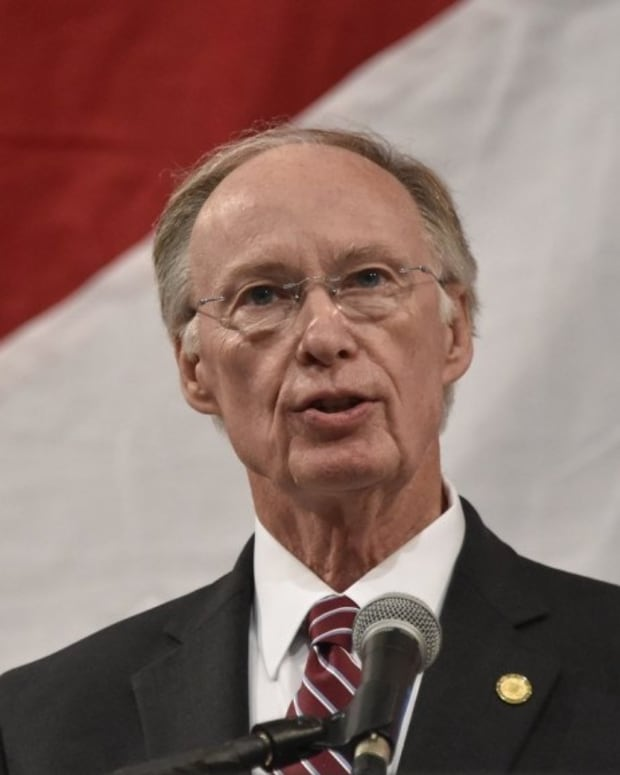 Alabama Gov. Uses State Helicopter To Get His Wallet Promo Image