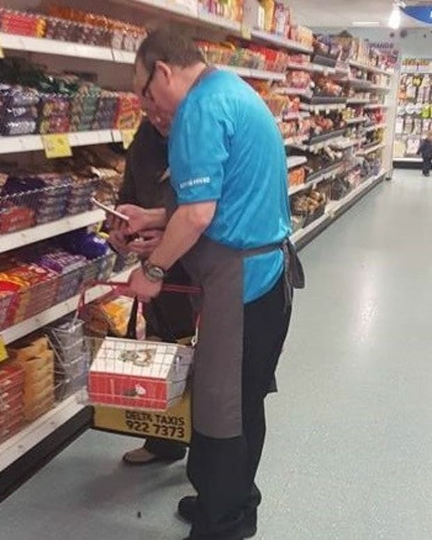 Photo Of Store Clerk Helping Elderly Man Goes Viral Promo Image