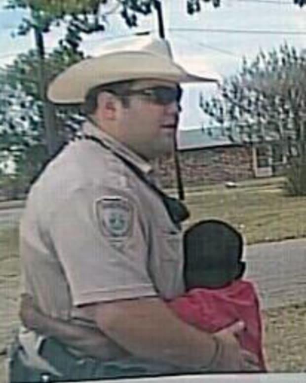 Boy hugging Texas deputy