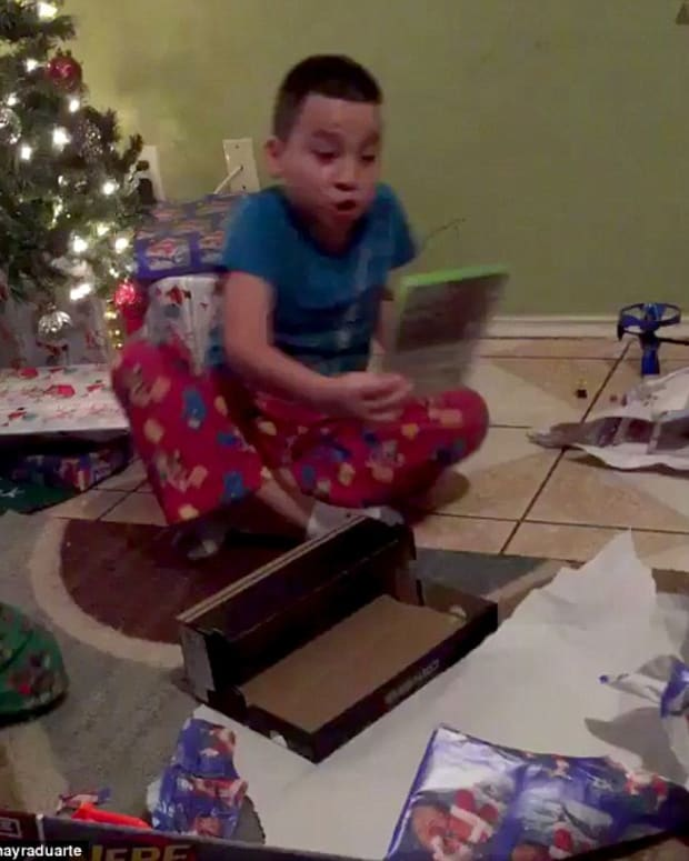 boy reacts to getting the 'wrong' gift