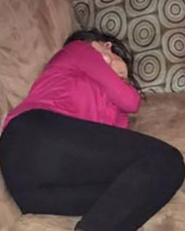 drunk girl sleeping on stranger's couch