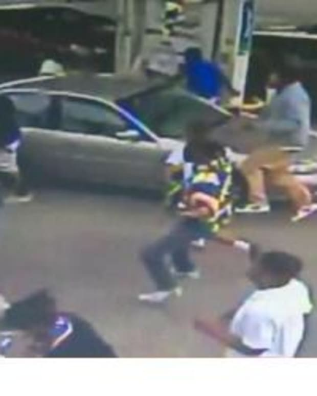 Watch: Man Holding Baby Encounters Enormous Group Of Teens In Gas Station Parking Lot (Video) Promo Image