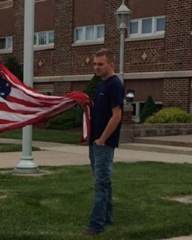 Teen's Patriotic Act Earns Praise Promo Image