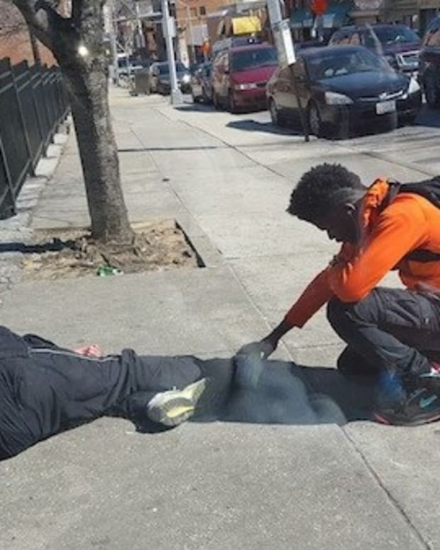 Teen Prays Over Homeless Man (Photos) Promo Image
