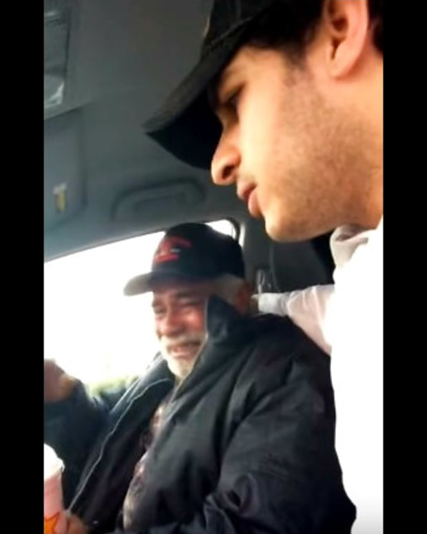 Max Zahir puts arm around emotional homeless veteran