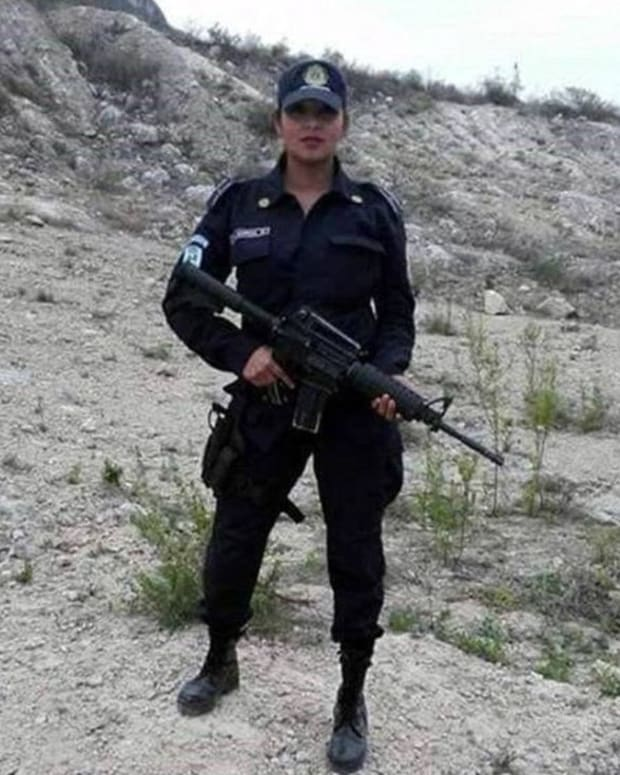Mexican Police Officer Suspended For Topless Photo Promo Image
