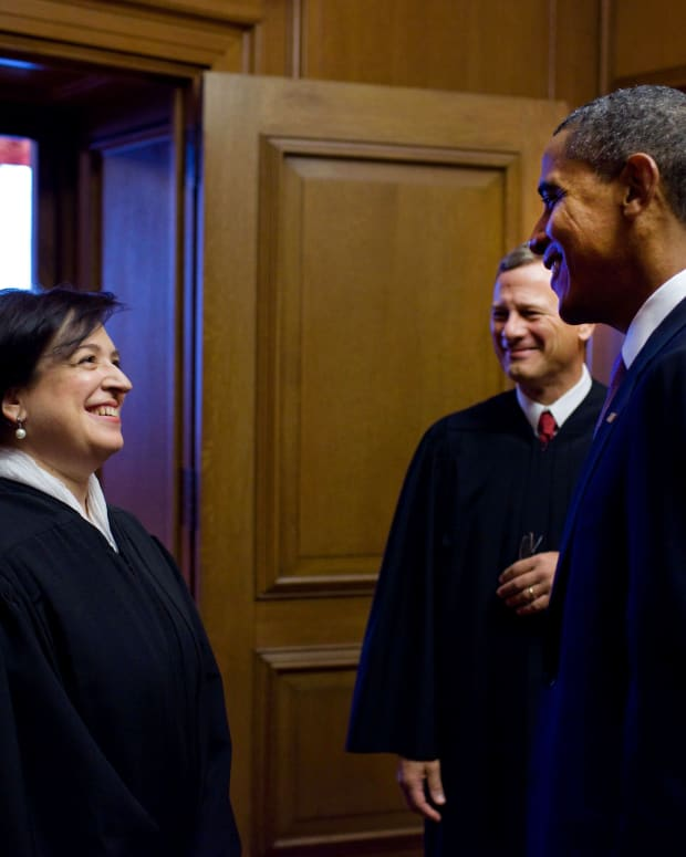 President Barack Obama with Justice Elena Kagan and Chief Justice John Roberts.