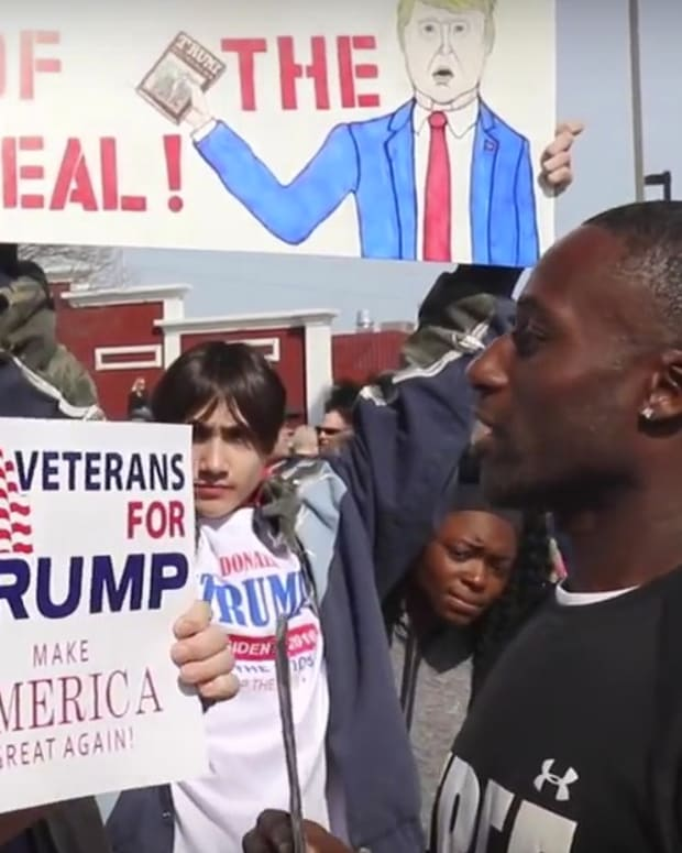 Black Man Offers Hugs At Sanders, Trump Rallies (Video) Promo Image